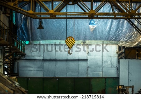 Industrial crain closeup photo indoors in blue