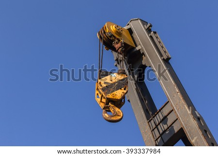 Industrial Crane Hook Arm Industrial construction mobile crane arm hook pulley section. - stock photo