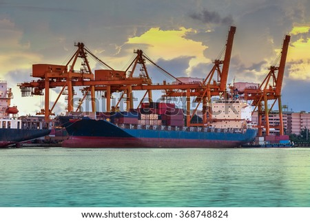 Industrial crane with Containers for Loading to a Cargo freight ship - stock photo