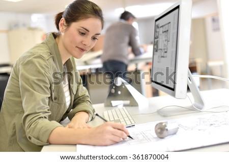 Industrial designer working on desktop computer - stock photo