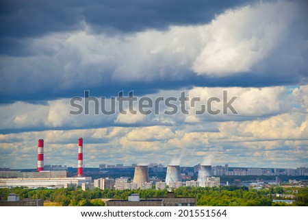 Industrial district, fuming industrial chimney. Blue sky with cumulus clouds - stock photo