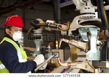 Industrial engineer activity in factory - stock photo