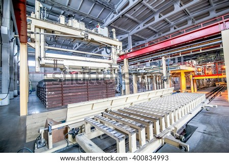 industrial equipment at the factory in a large production hall