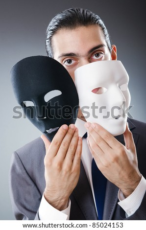 Industrial espionate concept with masked businessman - stock photo