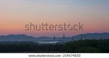 Industrial factory and mountains at sunset time - stock photo