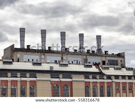 Industrial factory by Moskva river in Moscow Russia on a cloudy autumn day.