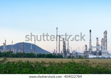 Industrial factory view from field at evening time