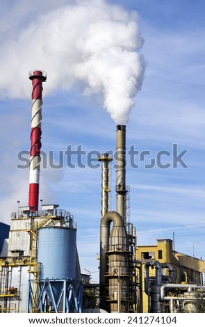 industrial  factory with tall fume towers - stock photo