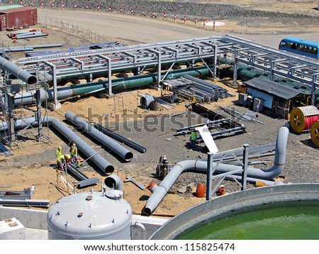industrial field pipe fabrication with supports - stock photo
