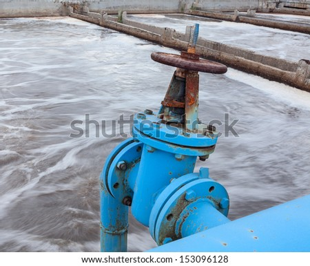 Industrial gate valve with blue pipeline for oxygen blowing into sewage water - stock photo