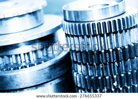 Industrial gear, cogwheels in workshop. Industry theme, background