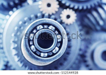 industrial gear machinery, engineering parts in blue toning - stock photo