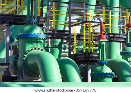 Industrial green tube on making petroleum plant - stock photo
