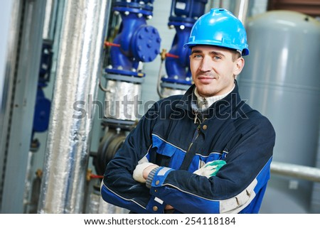 industrial heat engineer worker plumber at boiler room - stock photo
