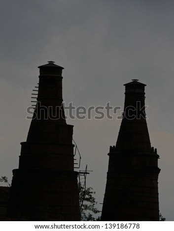 industrial heritage site with a historic building and the old red brick furnaces with high chimneys - stock photo