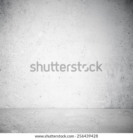 Industrial interior in shadow at stucco wall - stock photo