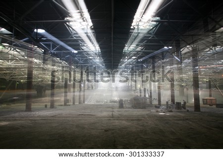 industrial interior of an abandoned building and repair work on the initial stage