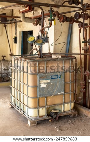 Industrial interior with chemical tanks closeup