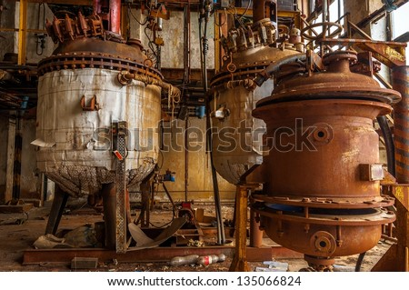 Industrial interior with storage tank in rusty colors - stock photo