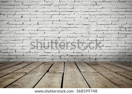 Industrial interior with wooden floor and brick white wall - stock photo
