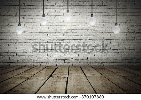 Industrial interior with wooden floor and brick white wall and bulb light on the roof - stock photo