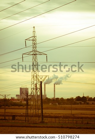 Industrial landscape - a view of the electric poles against the sky.