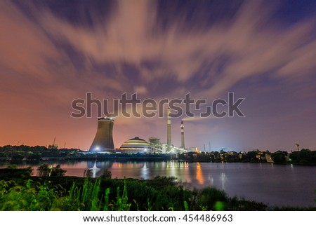 Industrial landscape , coal power plant in nightfall with beautiful movement of the clouds
