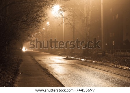 Industrial landscape of foggy town - stock photo