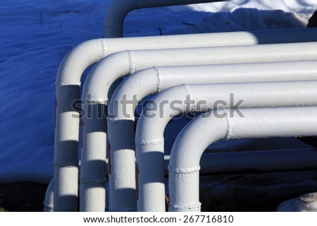 industrial landscape oil pumps in the early spring on a blue sky background - stock photo