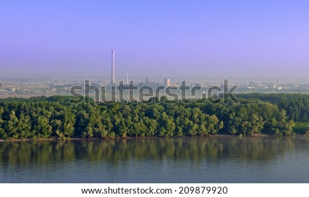Industrial landscape on river shore in Romania (Giurgiu) from Bulgarian side of Danube
