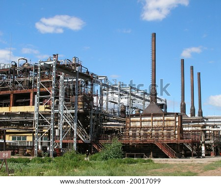 Industrial landscape. Reactors of pyrolysis on a chemical plant - stock photo