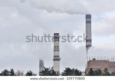 Industrial Landscape - Smokestacks Emitting Smoke into the Atmosphere