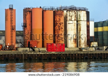 Industrial landscape; waterfront with reflections and plant  - stock photo