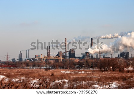 Industrial landscape with factory chimney - stock photo