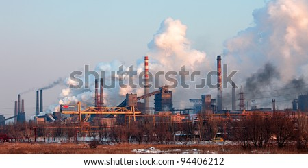 Industrial landscape with factory chimney and smoke