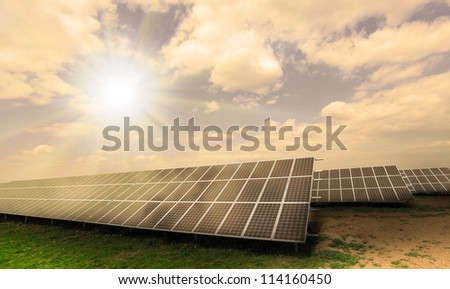 Industrial landscape with fotovoltaic power plant. Environmental concept - damaged landscape. - stock photo