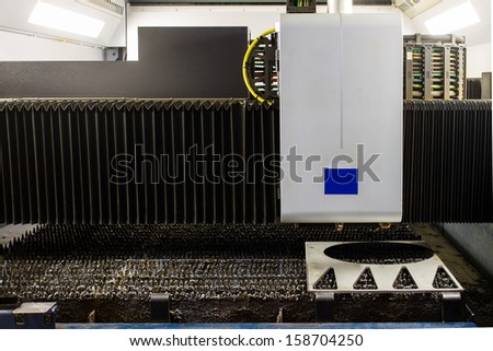 industrial laser cutter - stock photo
