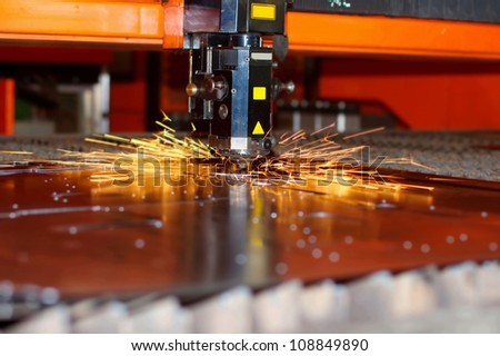Industrial laser with sparks - stock photo