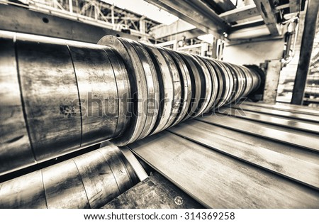 Industrial machine for steel coils cut. - stock photo