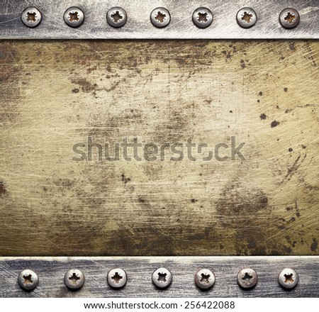 Industrial metal background with screws. - stock photo
