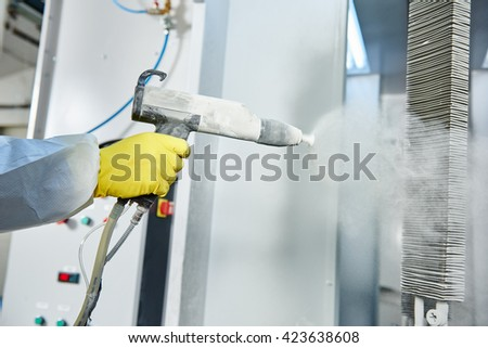 industrial metal coating. Man in protective suit, wearing a gas  - stock photo