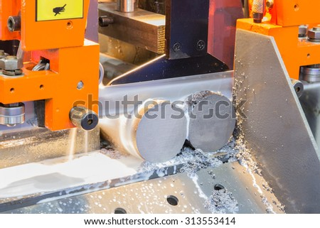 Industrial metal machining cutting process of blank  - stock photo