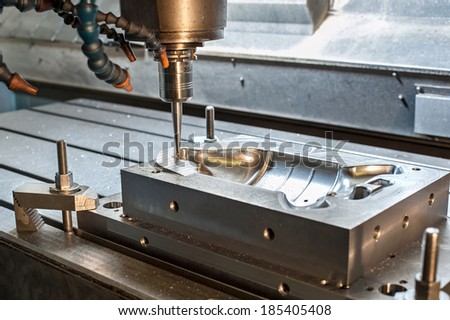Industrial metal mold/blank milling. Metalworking. Lathe and drilling industry. CNC technology. - stock photo
