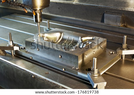 Industrial metal mold milling. Metalworking. Milling and drilling industry. CNC technology. - stock photo