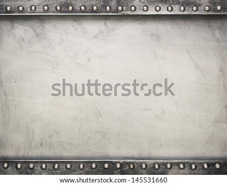 Industrial metal plate background with rivets - stock photo