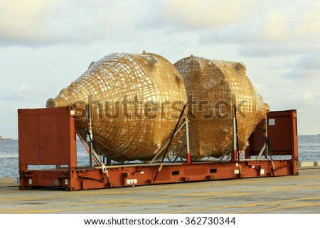 industrial object on flat rack container box waiting for shipping at harbour - stock photo