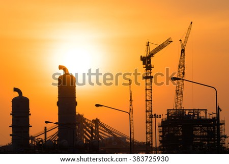 Industrial Oil refinery in building on sunset background at industrial plants, blur for backgrounds concept - stock photo