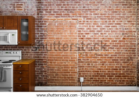 Industrial Old Flat Brick Wall Perspective in a kitchen. Perfect for Painting or Picture Frame Addition - stock photo