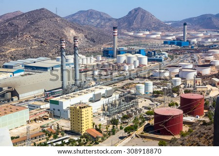 industrial park with log refineries - stock photo