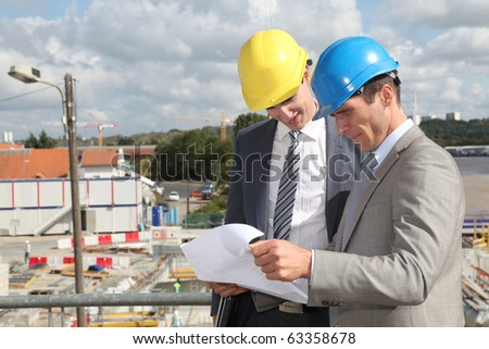 Industrial people looking at construction plan